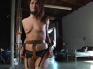Gagged sweetheart gets their way racks numerable with an increment of clamped