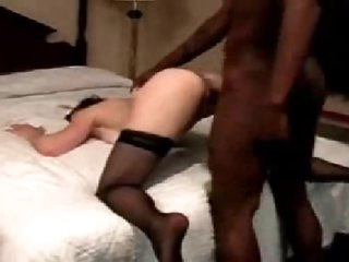 White wife in stockings goes darksome