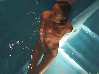 Daring solo young is fingering her shaved pussy in the pool