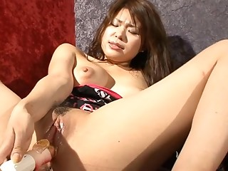 East slut in pink teases her shaggy cunt with large sex-toy