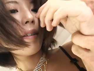Horny Oriental squirts with a large ramrod lodged all over her cunt and mouth
