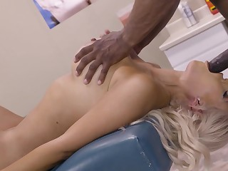 A blonde that loves black men is getting fucked by a broad in the beam cock