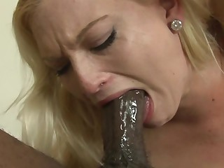 A blonde is with a black guy that has a expansive dick, having interracial sex