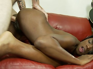 A black chick with a nice pussy is getting licked on the couch