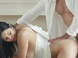 A busty princess with large knockers is bending over to take in a cock