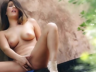 Scrumptious babe strokes and practices ID in the forest