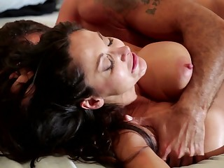 A sexy milf that loves riding cock is tasting a big one in bed