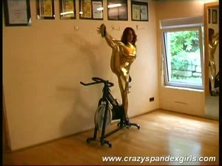 Acrobatic prostitute reveals jugs, stripping off their way acquisitive gold suit
