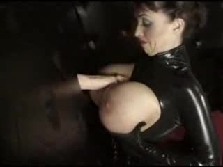 Gas main tit unladylike in latex gives gloryhole blowjob