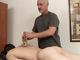 Skinny gay gets his hard cock oiled and massaged
