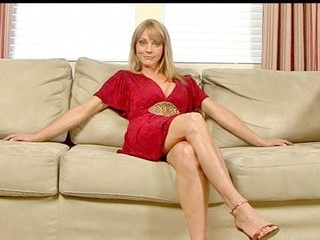 Sandy blond haired cougar masturbates with a long sex toy