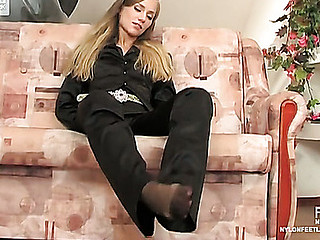 Footsy playgirl stroking her love tunnel throughout torn pantyhose previous to dildotoying