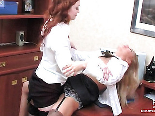 Cute office gals in strict matte stockings getting to strap-on sex on a desk