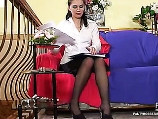 Female co-worker in dark tights wetting jock previous to taking it up her snatch