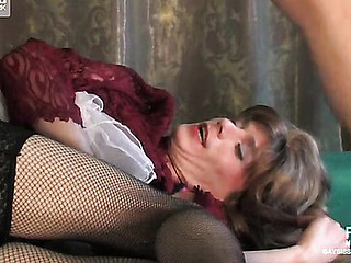 Clothed to kill sissy in a lacy dress and fishnets kneels down for dicking