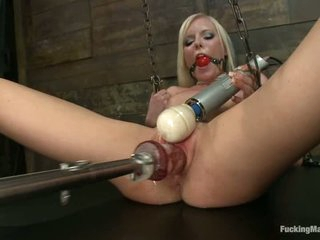 20 year old blonde Elaina Raye with small tits takes off her black panties to be banged by fucking machine. She finds red ball gag in her mouth and enjoys sex with dildo machine again.