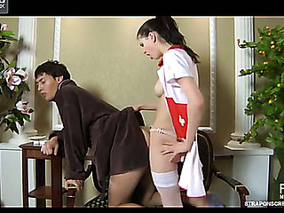Pretty nurse pokes a male booty with her gloved fingers and sizable strap-on
