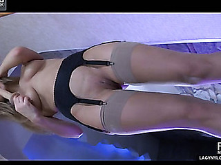 Pink wearing blondie spreads stockinged hands wide for orgasmic affectation penis play