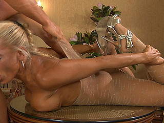 Muscled guy in pantyhose mask licks and stuffs the nyloned box of his playgirl