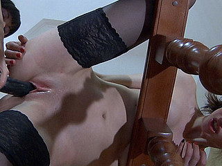 Doll-faced cutie gets to a strap-on fucking session with her next-door chick