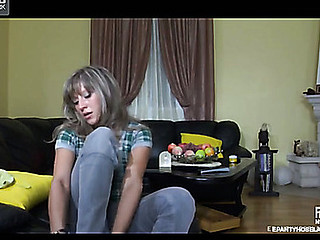 Wearing grey hose a sporty chick doing some exercises in the morning