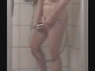 Mummy fingering while she takes shower