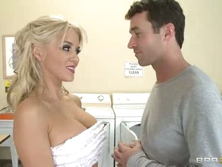 Busty blonde Tia McKenzie receives a schlong in the laundry room