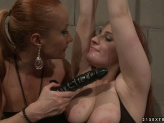 Katy Borman engulfing a dildo while her hands tied up