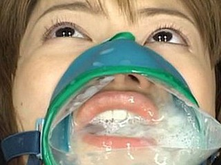 Ruri Anno is tied down and takes cumshots into this cum facial mask over her mouth and nose.