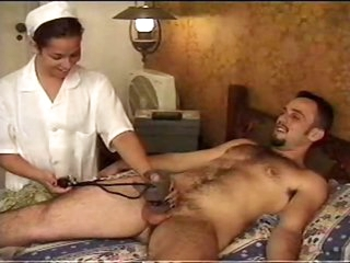 Nurse makes his knob hard with tease