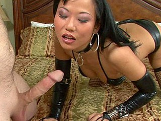 Exotic Asian mistress Niya Yu mixes leather and lace to get her fella rock hard.  This Babe expertly sucks him off, jacking him off with her tiny hands and the right amount of suction.  That Babe takes his cum all over her face with a large smile.  Now this is a girl who can't live out of her job.