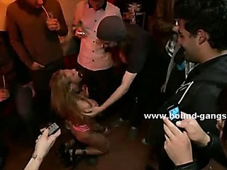 Blonde hottie undressed in club and bound in chains gets spanked and humiliated in nasty bdsm group sex