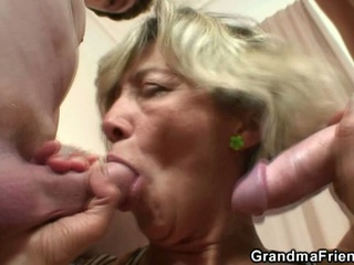 Old wench gives up her snatch for two young horny dudes