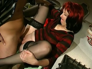 Redhead milf in stockings and heels acquires drilled