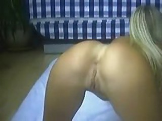 Wow! This is the most erotic video you've ever seen! Perfectly shaped tanned goldilocks probing both taut holes with blue dildo in doggy pose!