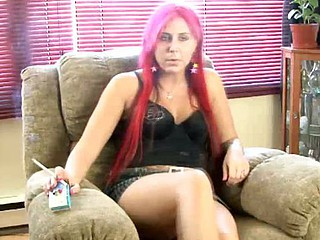 Redhead babe smokin' down in the mouth during interview