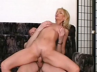 Hot golden-haired MILF acquires licked plus then rides his cock plus acquires fisted