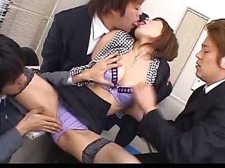 Japanese cougar Jun Kusanagi engulfing cock at one's fingertips the office