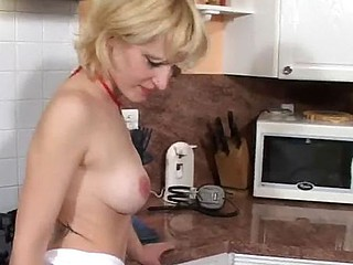 Skinny blond blows him together with acquires drilled about the arse about the kitchen