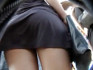 It was a windy weather and I was following the gorgeous chick in a tiny black skirt that was flying up and down played by the light wind with and letting me record her naked booty upskirt!