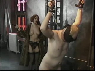 Redhead Mistress Taunts with Pang