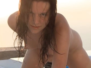 Brown haired wet girl Leo takes off her tiny bikini and poses naked in the open air after swimming in the pool. Naked young nude model Leo loves to pose outdoors.