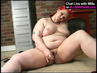 Plump tattooed redhead milla monroe plays with the brush toy