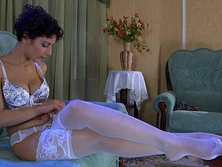 Bobbed dark brown hair lovingly smoothing her luscious white lace top nylons