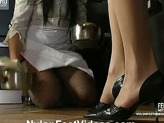 Salacious dame driving French maid mad caressing her with her nylon soles