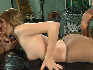 Nylon-addicted pair going down for wild hose sex right on the table