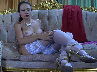 All-nude dreamboat slowly pulls up her luscious white nylons to go out