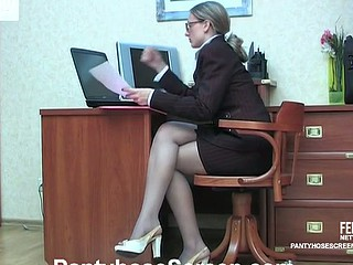 Female co-workers in stylish pantyhose savoring sexy cuddles and kisses in office