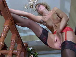 Heated blond fingering her crack in gartered two-color lace top nylons