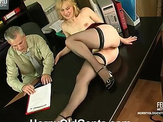 Nasty youthful secretary climbing her graying boss's desk for a hardcore fuck